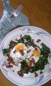 Local fresh eggs on local fresh kale